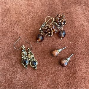 Three pairs of brown gold toned earrings